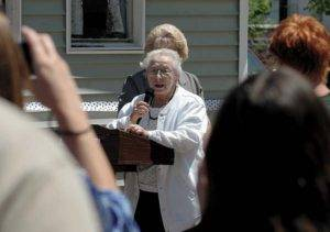 The Regional Animal Shelter Board member Peg Galpin speaks at the podium during the Regional Animal Shelter Annex ribbon-cutting ceremony in Gloversville on 5/17. The Leader-Herald/Bill Trojan