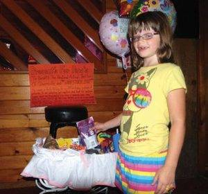 Faith McCoy wanted her friends to give her donations for Woofstock instead of presents for her eighth birthday Saturday. The Leader-Herald/John Borgolini